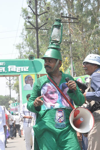 """Lalu's party workers and supporters have literally painted Patna green with green flags, green caps and green banners,"" a district police official said."