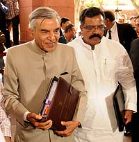 The Union Minister for Railways,  Pawan Kumar Bansal along with the Minister of State for Railways,  K.J. Surya Prakash Reddy arriving at Parliament House to present the Rail Budget 2013-14, in New Delhi on February 26, 2013.